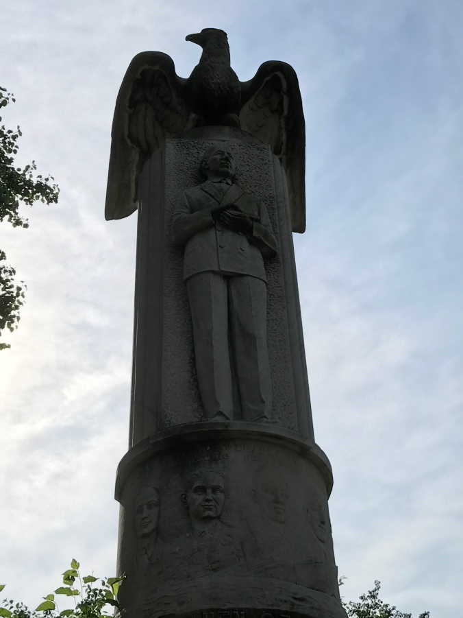 Suddenly Mad- Flummoxed (Marconi with eagle sculpture Church Square Park)