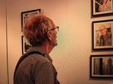 Suddenly Mad- Photo exhibit -bob looking at photos