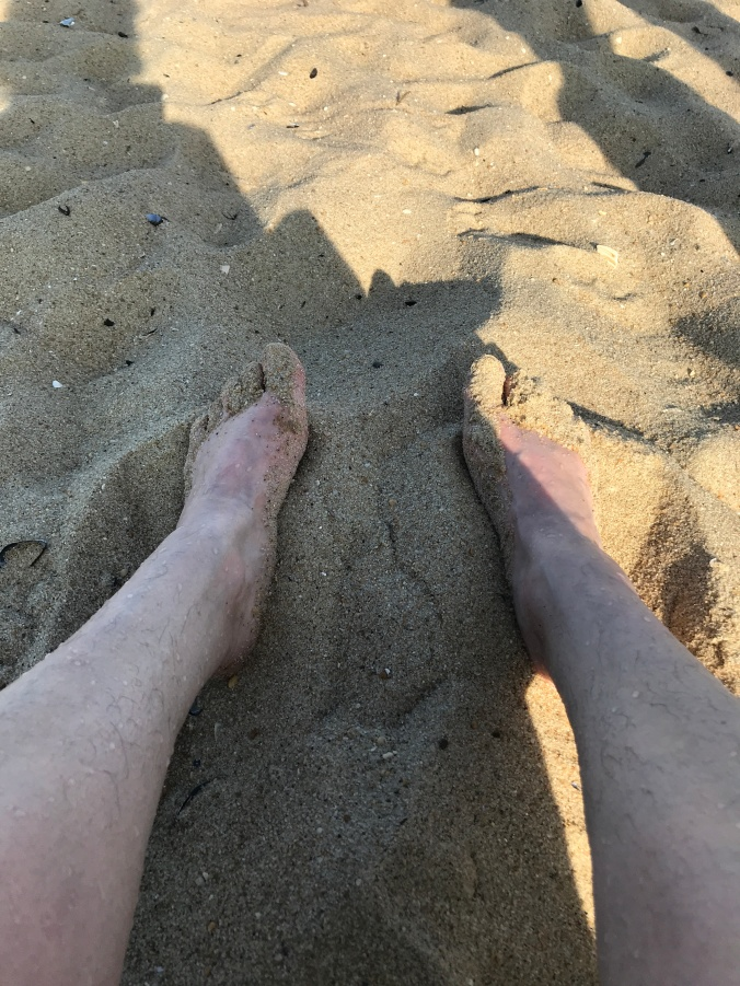 Suddenly Mad- my feet in the sand after I stepped into the water