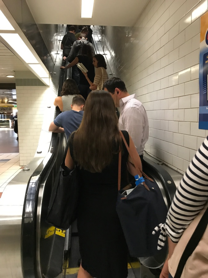Suddenly Mad- Port Authority escalator with people waiting for the bus