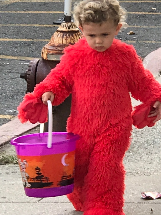The Beginning, The Middle and The End (Halloween child maybe Elmo)