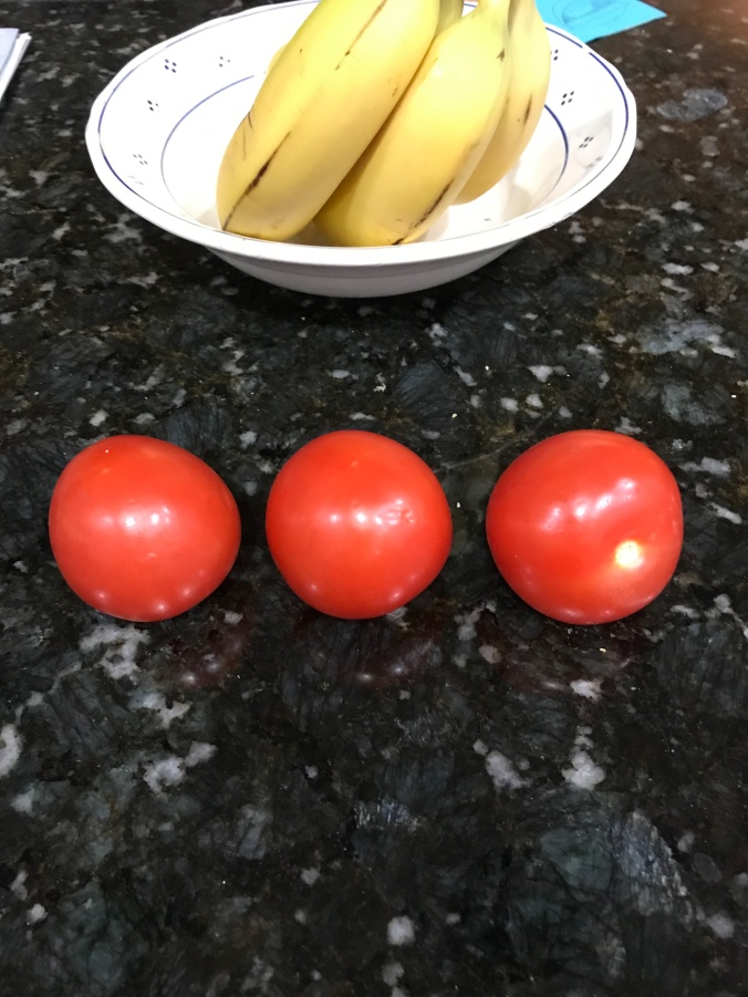 suddenly mad- solitary confinement ( photograph of tomatoes and bananas)