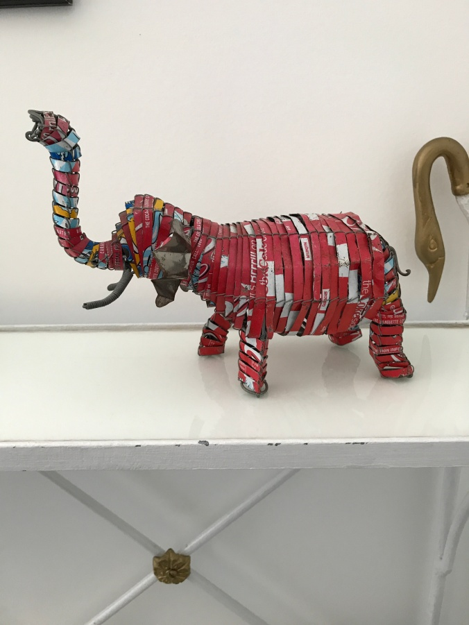 Suddenly Mad- Impermanence and Change (elephant made from cut coke cans African Art at Dina's apartment)