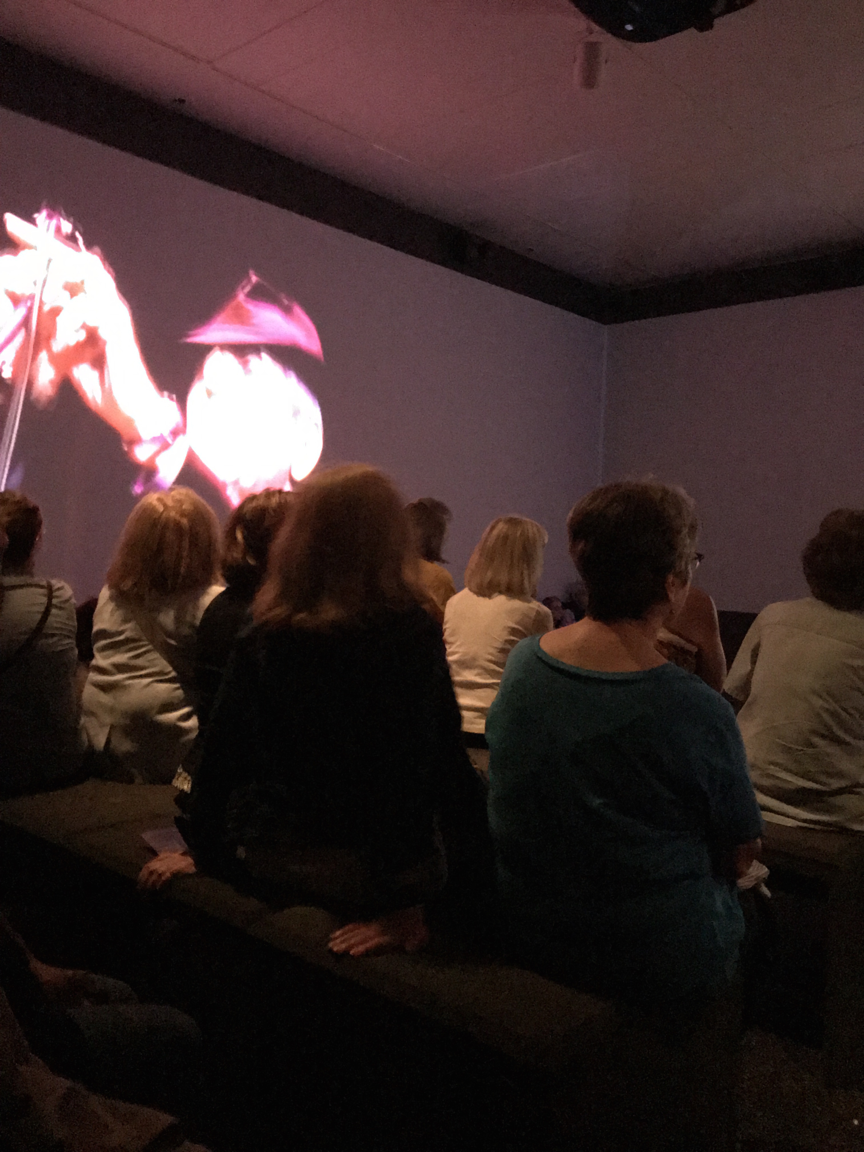 Leonard Cohen exhibit at The Jewish Museum (audience watched the conjuring of Cohen in films)