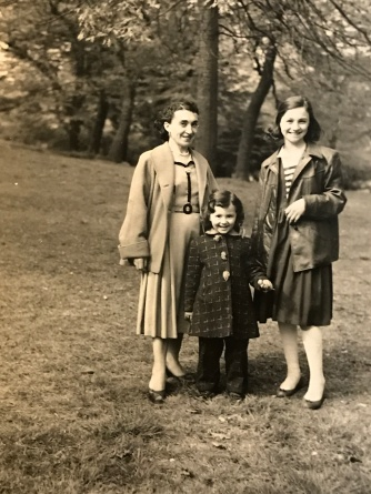 Suddenly Mad- Poof! (Photo from 1958 my mother Sonia, me and my sister Lillian in St. James park in the Bronx)